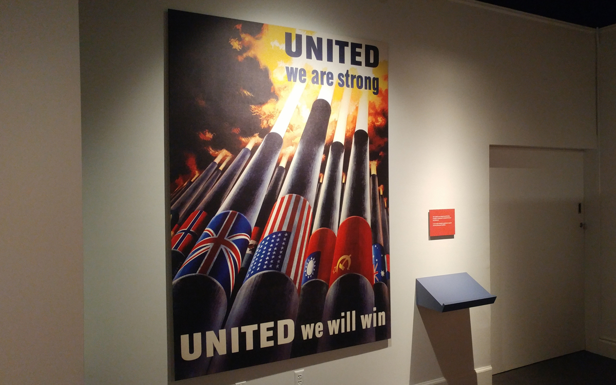 """Wall mounted panel reading """"United We are Strong, United We Will Win"""" for a museum permanent exhibit installation"""