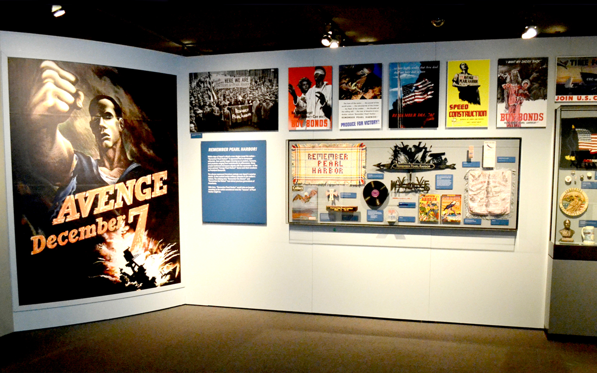 Wall mounted graphic panels and display case at the FDR Presidential Library and Museum exhibit