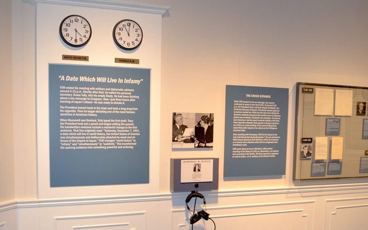 Wall mounted display cases, interactive listening device and and graphics in the FDR museum exhibit
