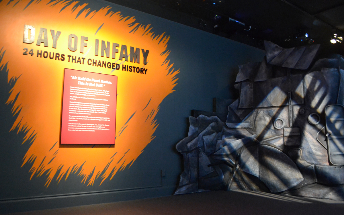 Custom fabricated museum exhibit ship display with wall graphic and dimensional letters for the Day of Infamy at the FDR Museum