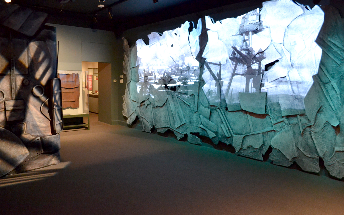 Museum exhibit wall projection on custom fabricated dimensional wall and ship for the Day of Infamy