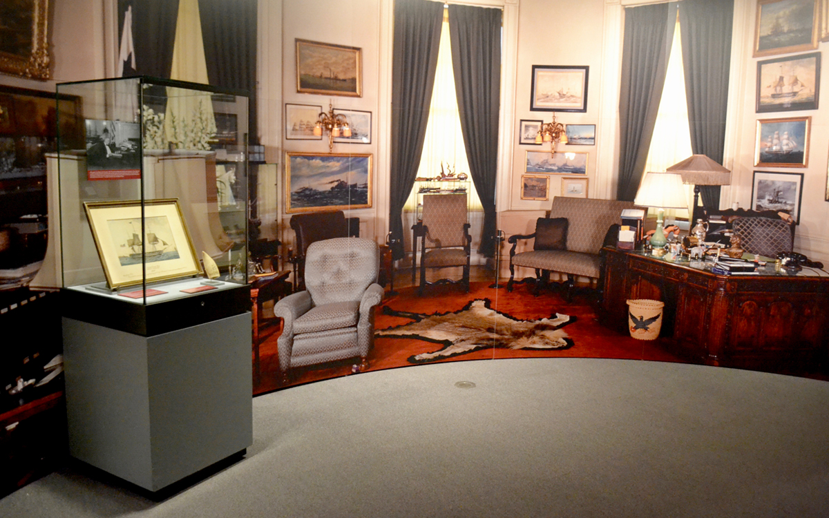 Custom wall graphic depicting FDR's study with custom display case for museum exhibit