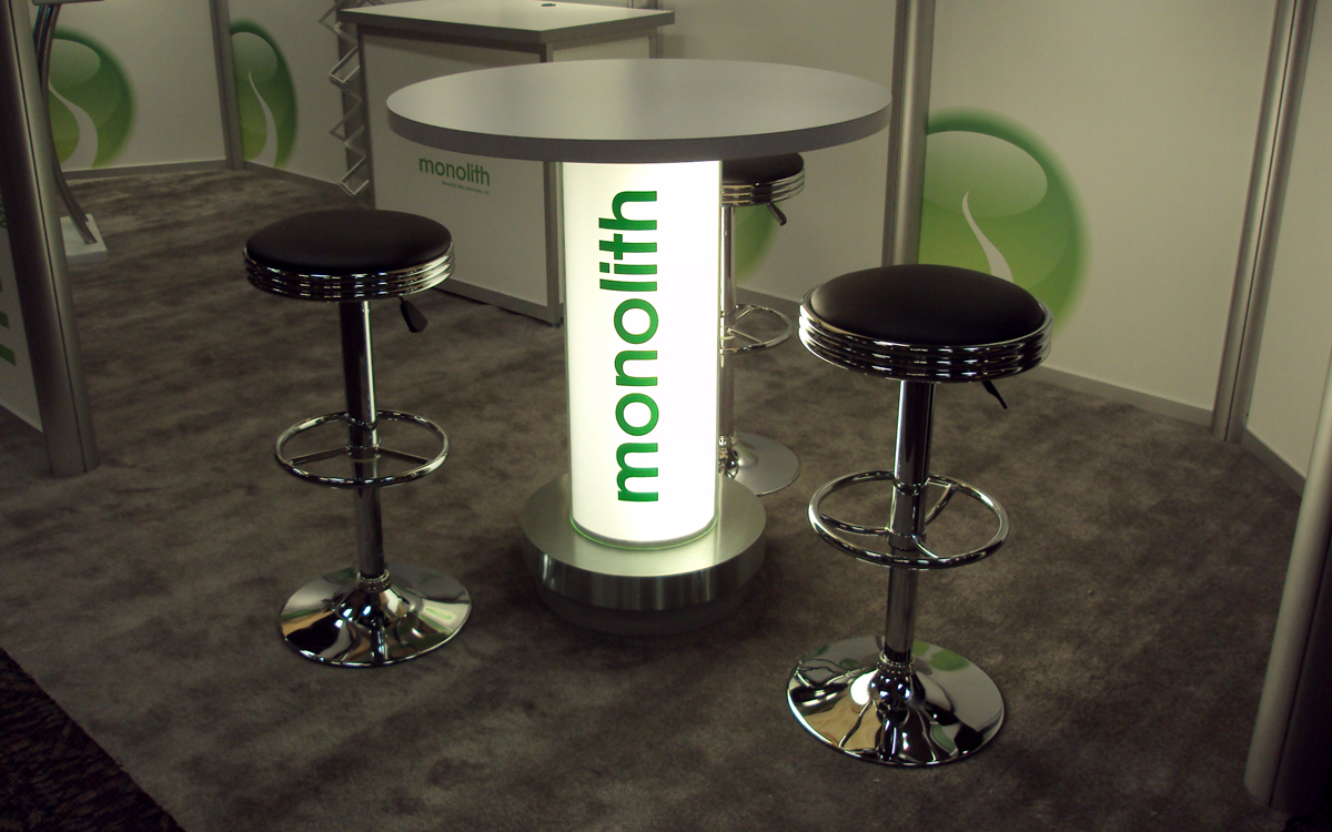 Backlit bistro table with glowing logo for the Monolith Solar trade show booth
