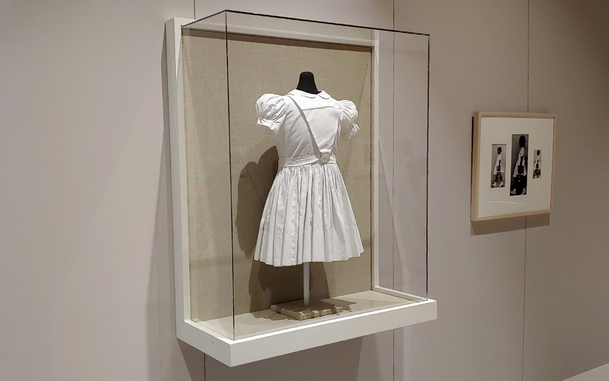Custom built wall mounted display case holding a dress in the Norman Rockwell Museum