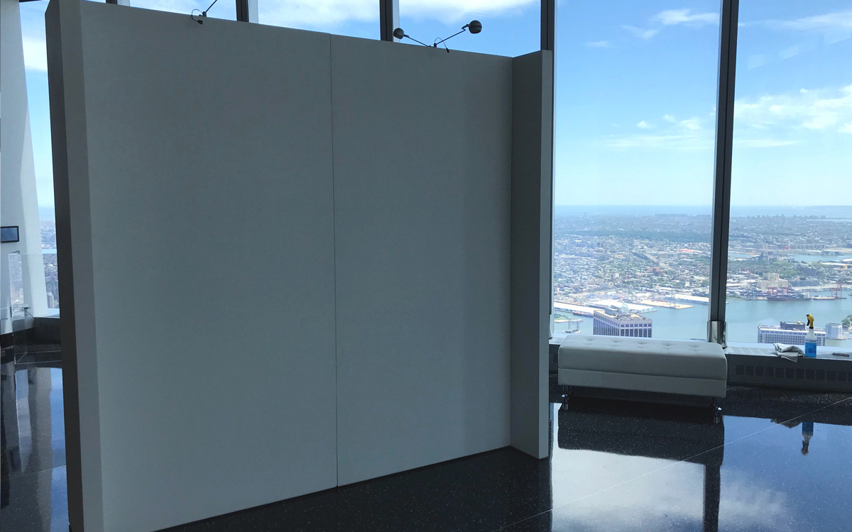 Rental gallery walls near window with view of New York City and the water