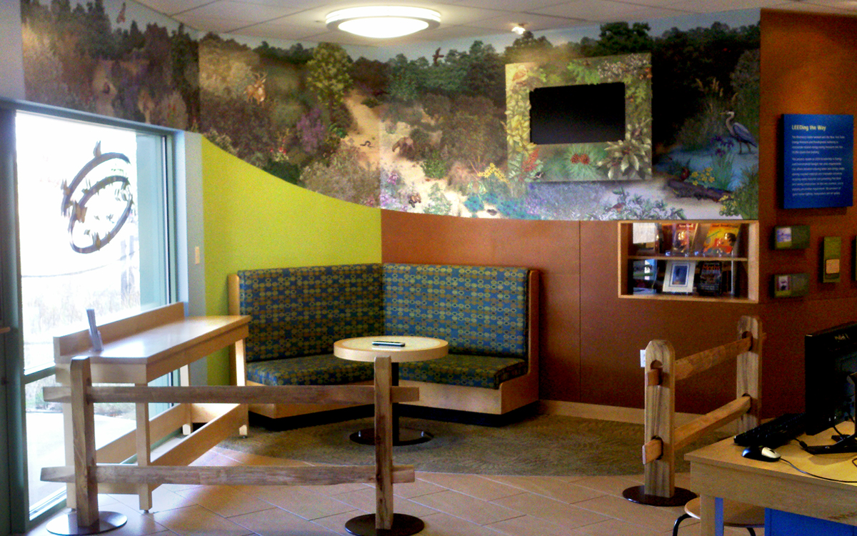 Custom Environment with lightbox table, concealed monitor and wall graphics