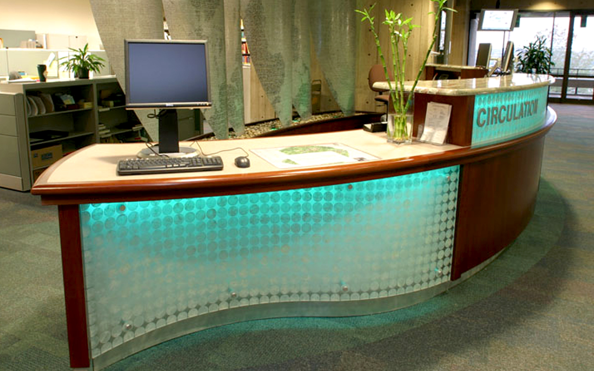 Custom built circulation desk with backlit acrylic sides and granite insert top designed and fabricated for RPI Folsom Library