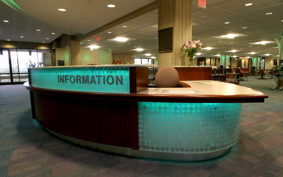 Custom built information desk with backlights, granite and rich wood in the Folsom Library at RPI