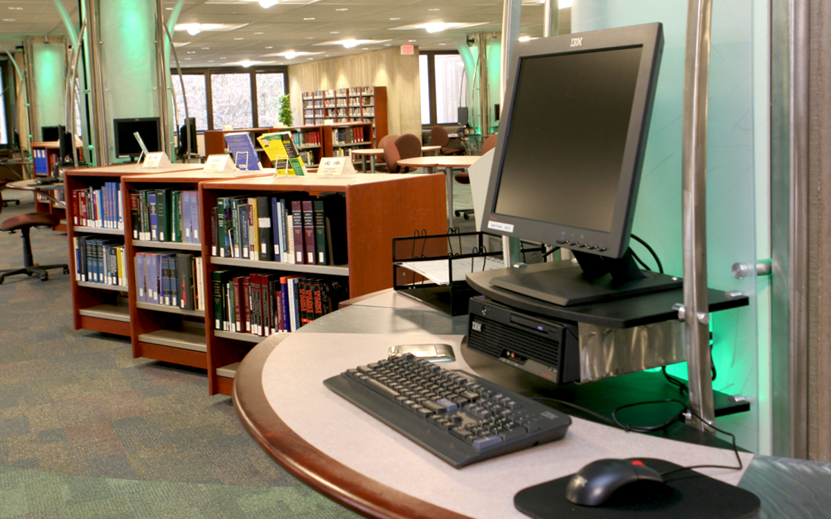 Custom built workstations with teal lighting at RPI library