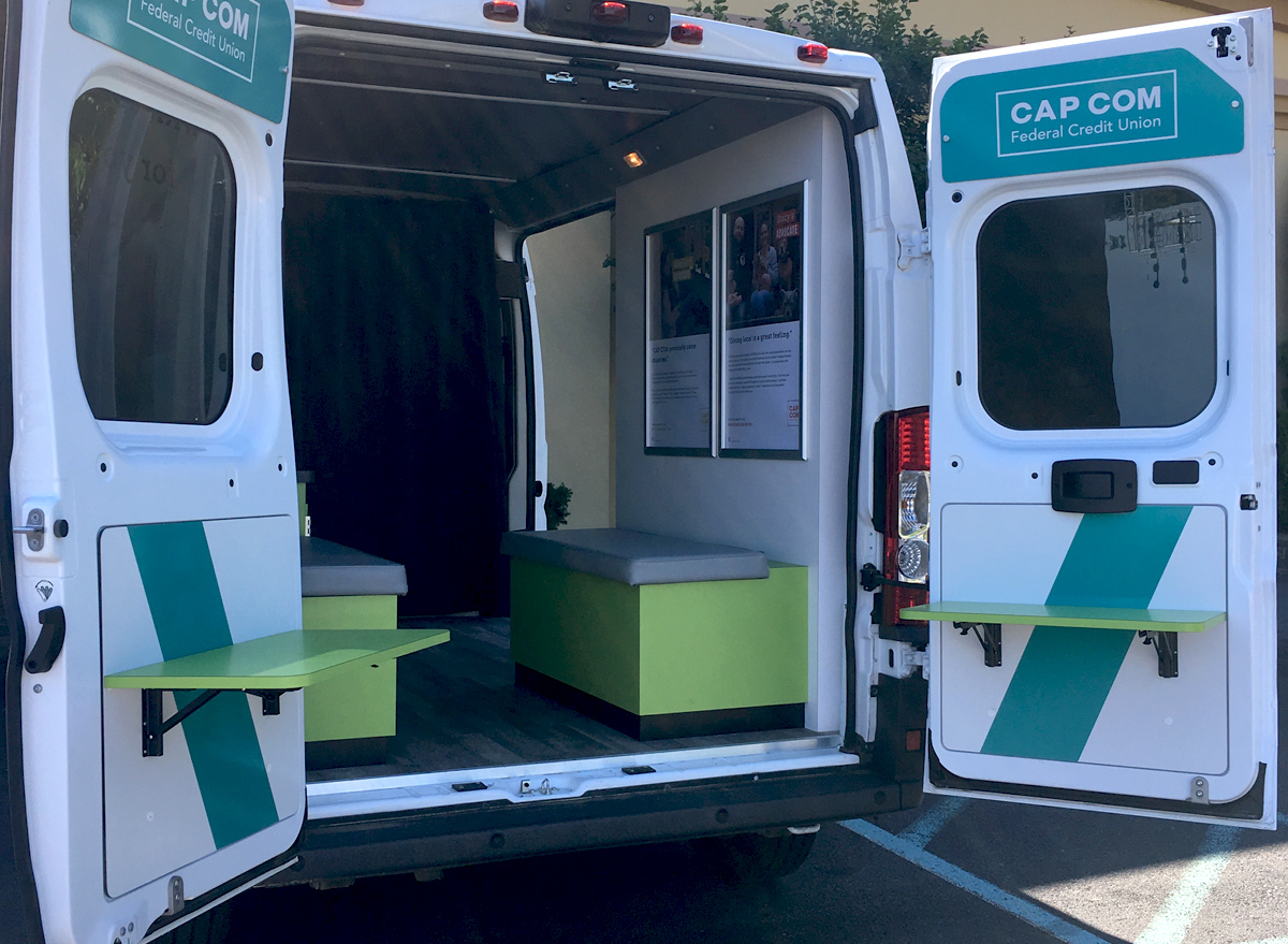 Banking van custom environment with back doors open to interior