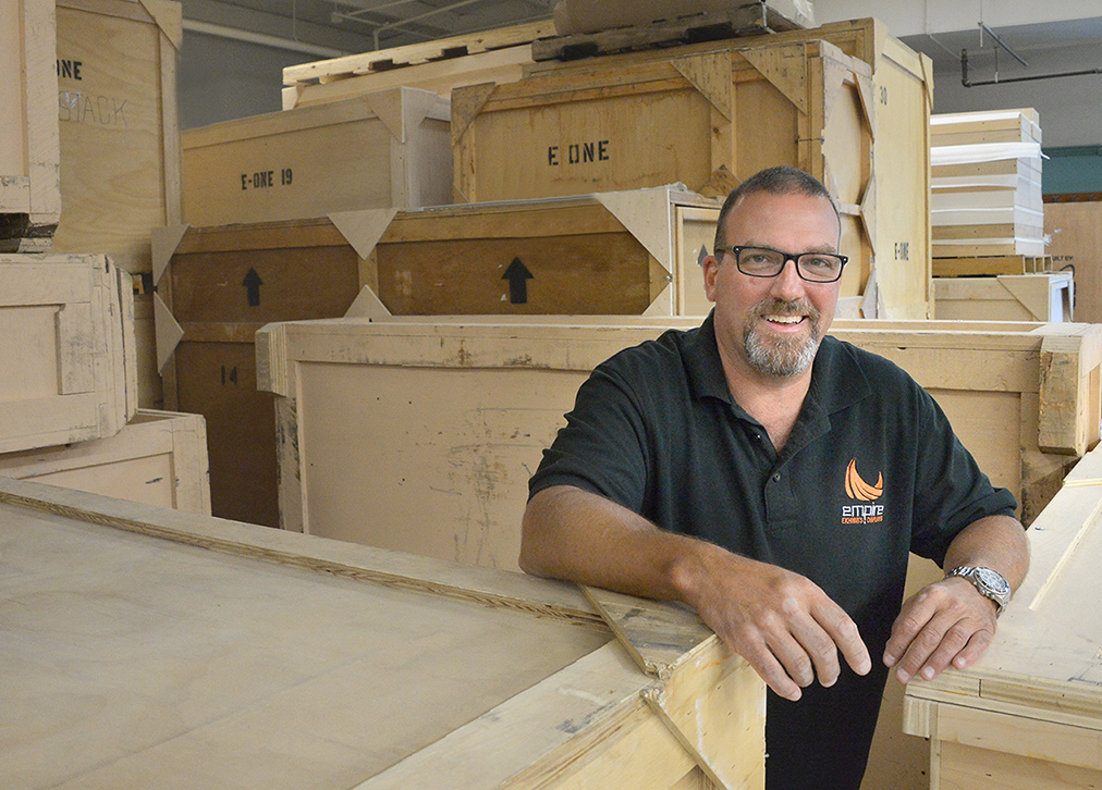 Empire Exhibits Owner with custom crates in shop