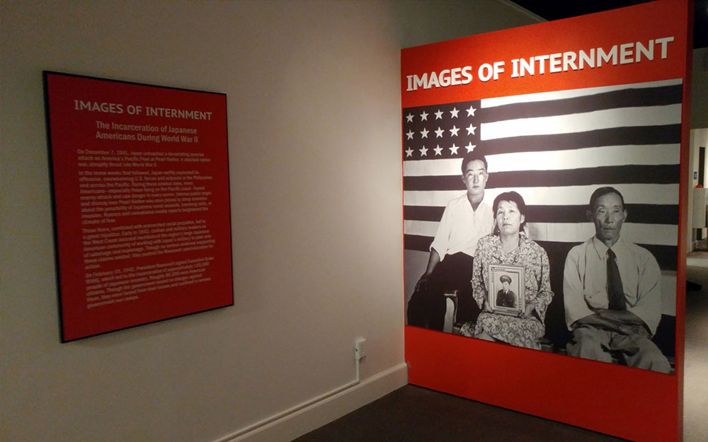 large format print and dimension letters reading images of internment at FDR museum