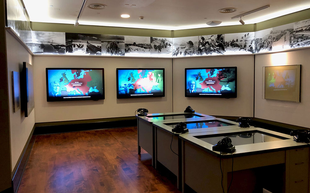 FDR map room museum exhibit with monitors and panoramic print