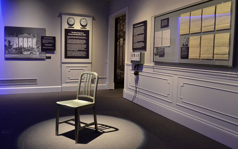 museum exhibit with spotlight on chair for new york museum by empire exhbiits
