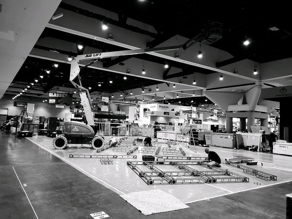 convention hall installation of trade show booth with crane