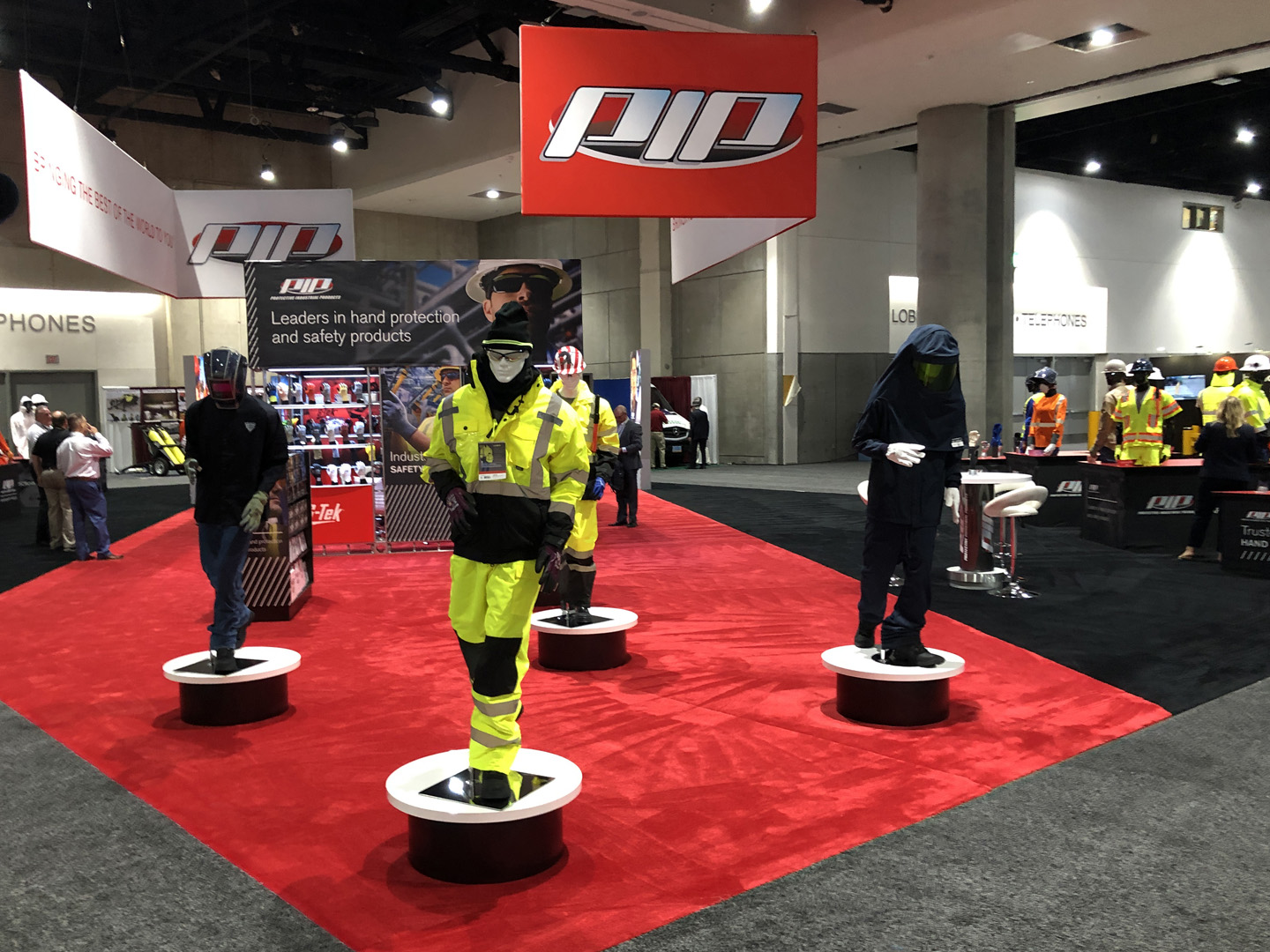 mannequins in trade show exhibit booth for PIP