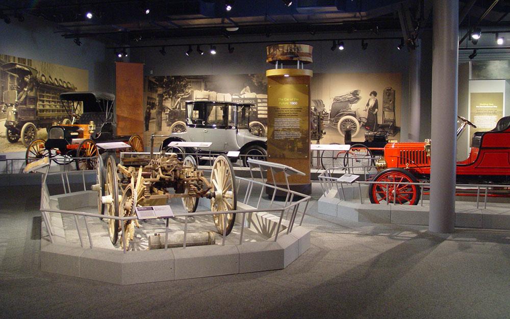 America on Wheels museum exhibit custom railings and graphic panel display tower around car displays