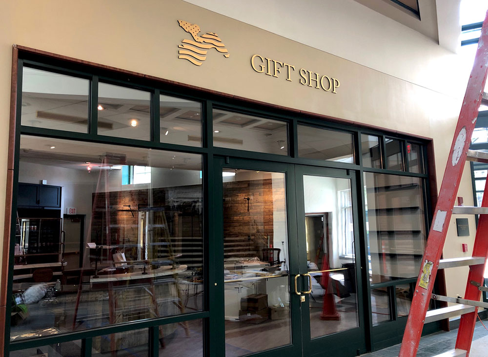 Bronze gift shop dimensional letter sign installed at museum