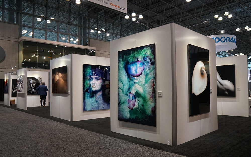 Rental wall system with hanging artwork in show setting