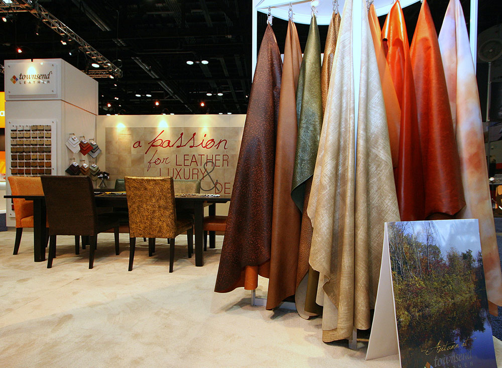 Trade show exhibit booth with seating and sample racks for Townsend Leather