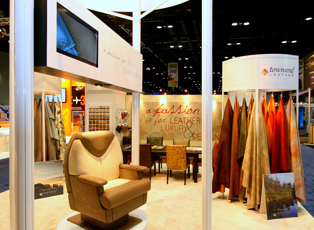 Leather chair and monitor in trade show booth. seating and sample racks for Townsend Leather