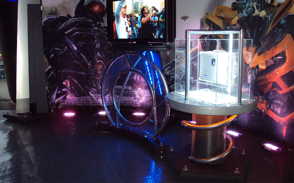 Custom built kiosk and monitor with colored lighting and display case