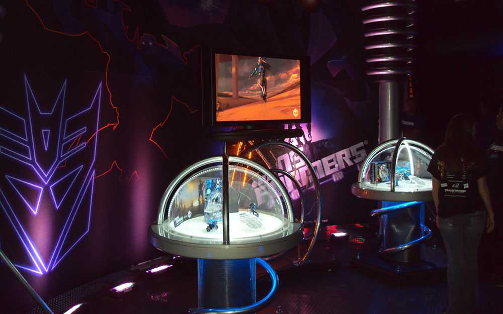 Custom built kiosk and monitor with dramatic colored lighting and display case