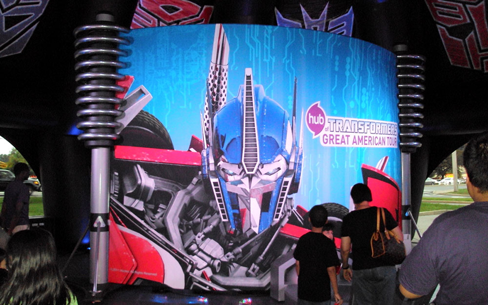 People in line for the Optimus Prime wall graphic and hand photo op