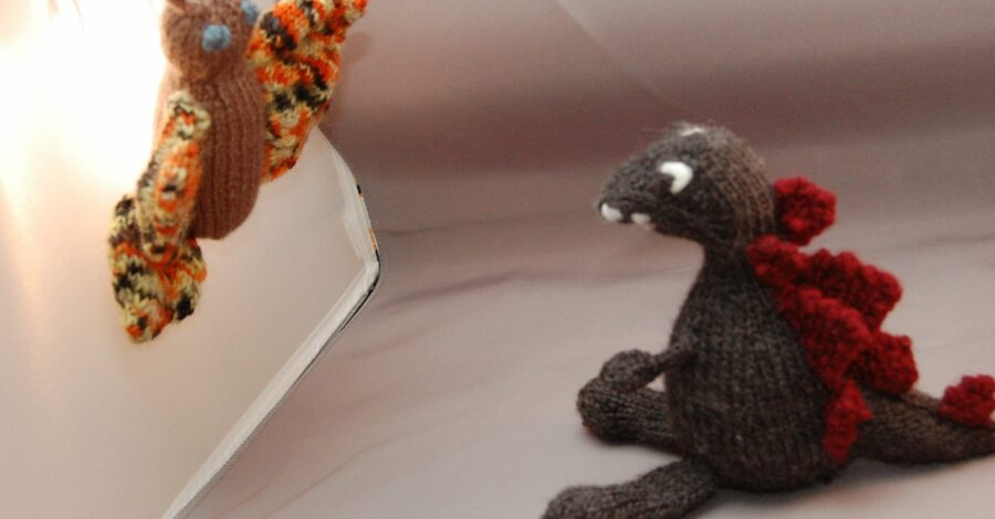 mothra v Godzilla made out of yarn knit