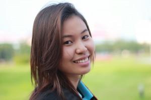 Eastern Woman smiling in open green grassy field