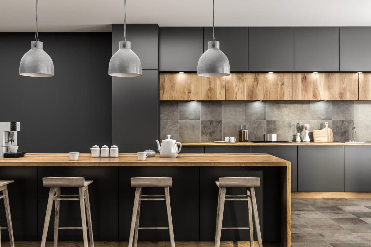 Modern kitchen interior with gray walls, tiled floor, gray countertops and wooden bar with stools. 3d rendering