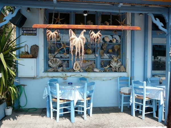The corner Greek taverna: haven of communion and conviviality.