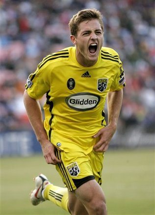 Winger Robbie Rogers comes out, retires from soccer.