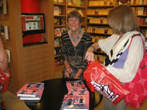 Happily signing books at the Delicious Book Presentation on May 22nd.