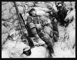 Solider asleep in the trenches, WW I.
