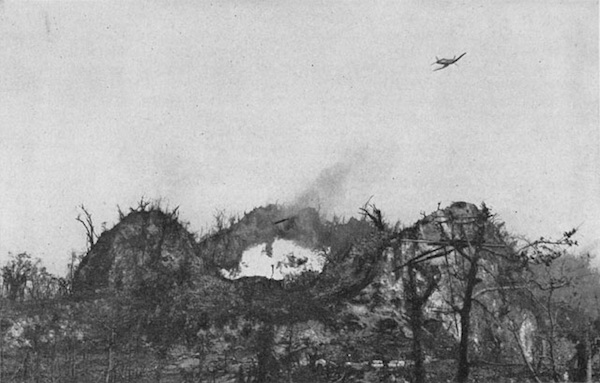 Corsairs drop napalm on Bloody Nose Ridge.