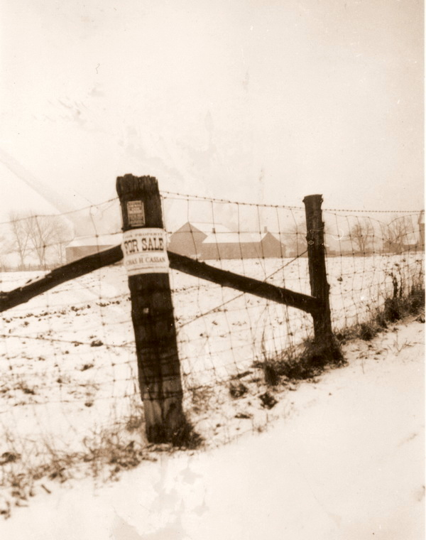 """""""Property-poor"""": a futile for-sale sign on a homestead, 1930s."""