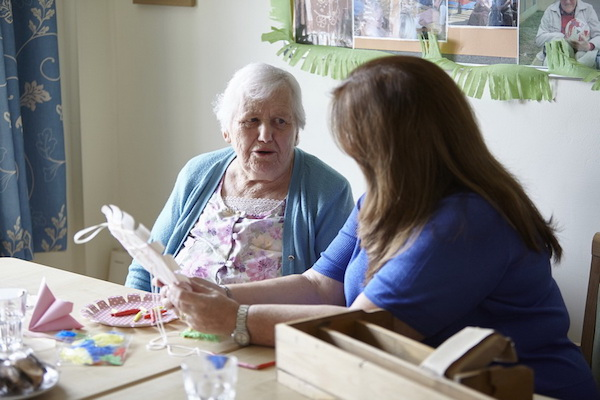 Caregiver and client (Amarna House Care Home, York).