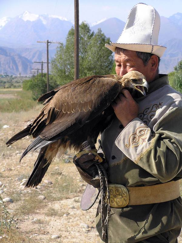 A traditional eagle hunter and his bird.