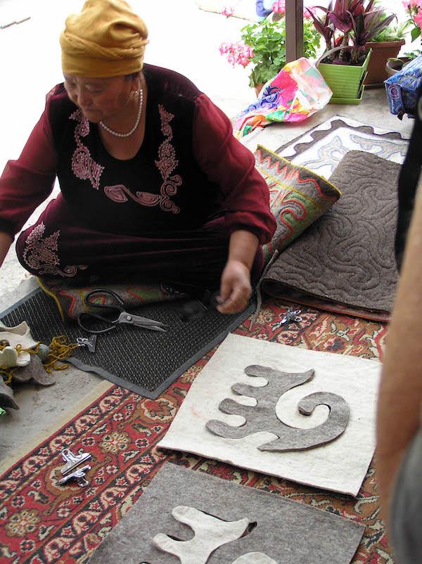 Feltmaker creating shydrak mats.