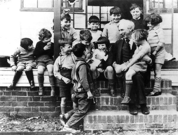 Bertrand Russell (1872 – 1970) with a group of children at Beacon High School. (Photo: Keystone/Getty Images, 1950.)
