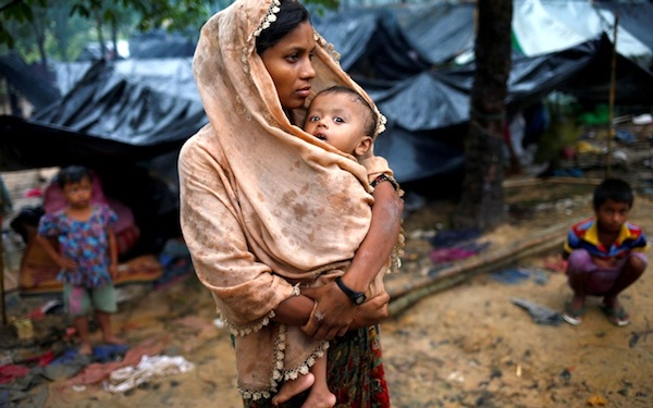 On Bangladesh's border, Rohingya woman and her baby. (Photo: Reuters[https://curious.com/curios/14290#date].)