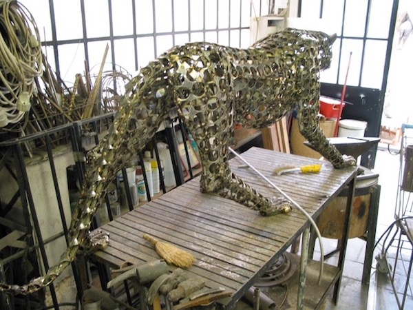The leopard, still in the studio, poised to attack.