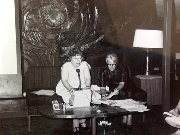 Jacky Tyrwhitt taking notes as Margaret Mead speaks.