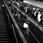 Commuters riding the escalators during the evening commute at a T station in Cambridge, Massachusetts. (Photo: Cassandra Zampini.)