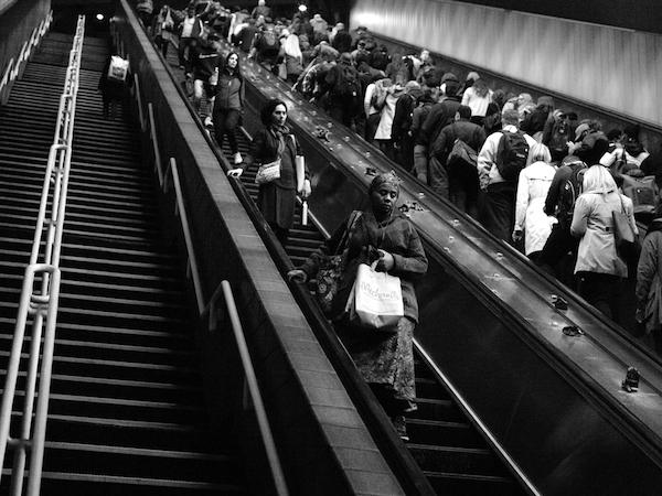 Commuters riding the escalators during the evening commute at a T station in Cambridge, Massachusetts. (Photo:Cassandra Zampini.)