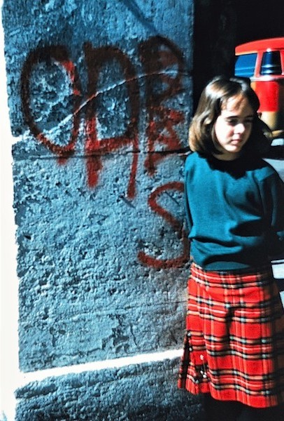 In a Scottish kilt and sweater, 1962.