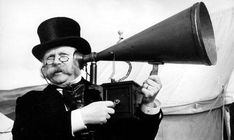 Vintage ear trumpet cum mutton chops.
