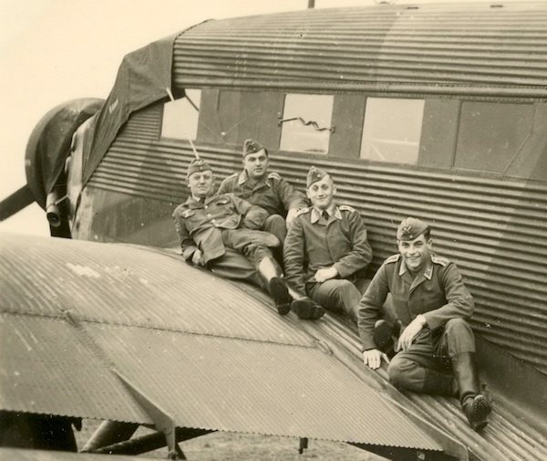 """""""They do not spend much time imagining past or future."""" Group on wing of a Ju-52 transport."""