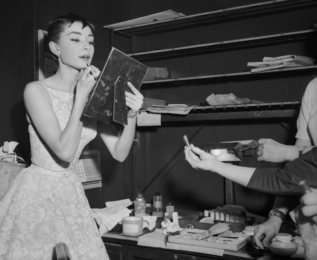 25 Mar 1954 --- Original caption: Audrey Hepburn, Dutch born darling of American film, won a coveted Oscar for the Best Performance by an Actress. The lovely 22 year old actress hit the jackpot with her first American film, Roman Holiday. Here, she is shown in the dressing room of the Center Theater, where she changed after coming from the 46th Street Theater, where she was appearing in Ondine. --- Image by © Bettmann/CORBIS